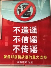 """A banner in China that advises people: """"Do not make up rumors. Do not believerumors. Do not spread rumors."""""""