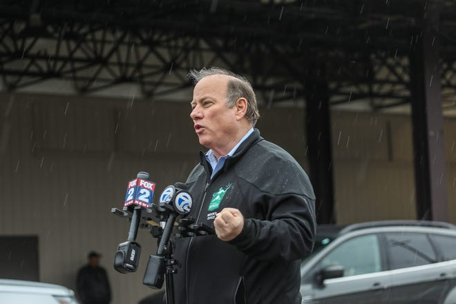 Detroit Mayor Mike Duggan holds a press conference in front of the Joe Dumars Fieldhouse at the COVID-19 regional testing facility on the Michigan State Fairgrounds in Detroit on Saturday, March 28, 2020.