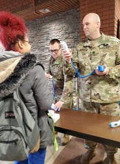 Michigan National Guardsmen screen essential staff at the Grand Rapids Home for Veterans for symptoms of COVID-19 on March 20, 2020. The Michigan National Guard is supporting local first responders and state agencies in their response to COVID-19.