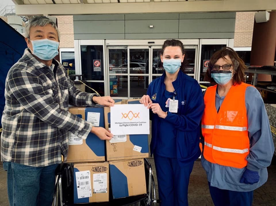 Charles Liu, Carolyn Nancarrow and Brittany Palaian , members of the Michigan Chinese American Coalition, are providing Covid-19 hospital supplies to  St. Joseph Mercy Hospital and 28 other hospitals and senior facilities. The organization has given out $200,000 in face masks, googles and coveralls.