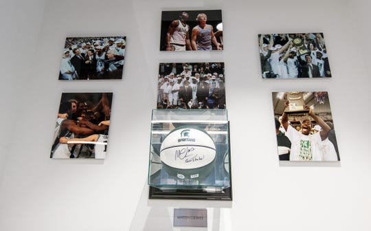 Photos from Michigan State University basketball team's national championship journey and a basketball signed by Mateen Cleaves, who is currently a leadership coach at the United Shore, inside of the Breslin conference room at United Shore headquarter in Pontiac, Friday, Feb. 28, 2020.