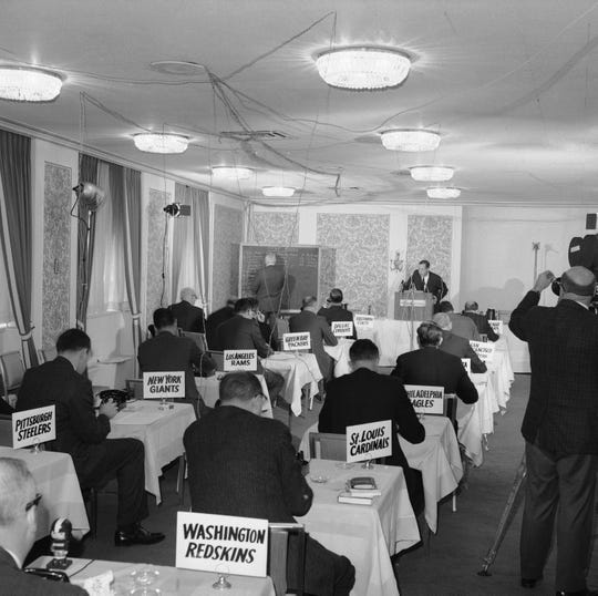 This Nov. 26, 1964 file photo shows a general view of the National Football League draft meeting in New York.
