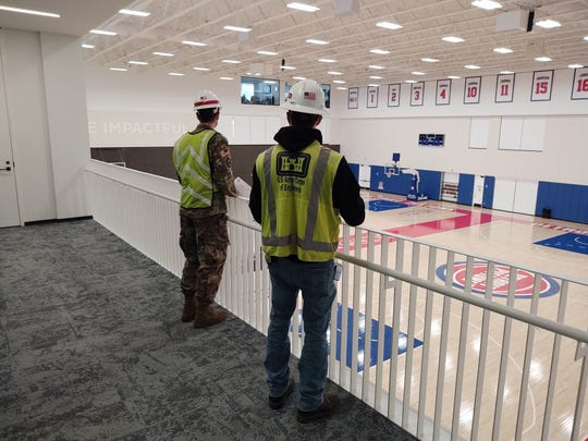 U.S. Army Corps of Engineers staff assess a Detroit Pistons practice location as a possible site for an alternate facility to host overflow of coronavirus patients from Michigan hospitals.