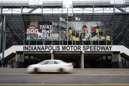 A car drives past the entrance at the Indianapolis Motor Speedway in Indianapolis on Saturday.