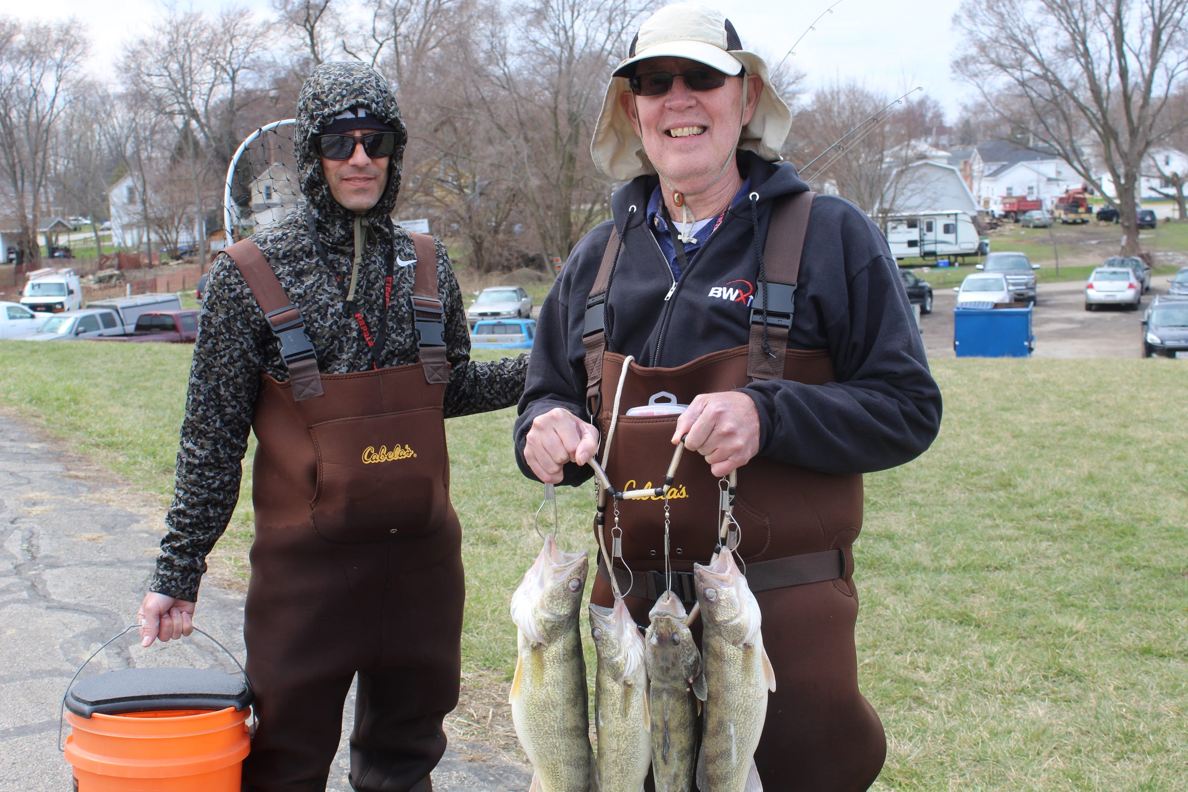 Jerry Dobbins of Doylestown holds four walleye he caught Thursday in the Sandusky River as he fished with his son, Jerry Jr., of Barberton. The Dobbins were among several fishermen that come to Fremont every year for the annual walleye run.