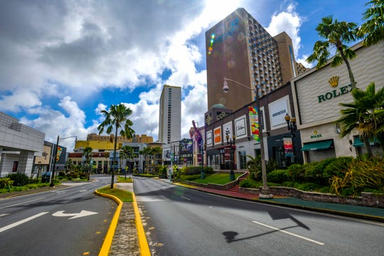 Normally bustling with traffic and sidewalks crowded with visiting tourists, Paradise Island in Tumon is found to be void of vehicles and the pedestrian traffic on the afternoon of Sunday, March 29, 2020, after shopping venues and other visitor industry-related businesses were closed in an effort to reduce the spread the coronavirus.