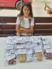 Guam Girl Scout and Tiyan High School student Emma Flores, 15, made masks for store patrons who didn't have any so they could shop during the coronavirus pandemic.