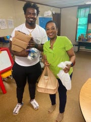Former Mississippi State center Darryl Williams and Jefferson County (Bessemer Division) District Attorney Lynneice Washington distributed food to people in need throughout their community last week.