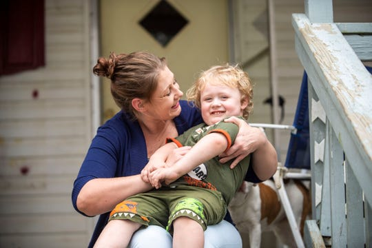 Samantha Thiel tickles her 3-year-old son, Joseph, as they pose for a picture outside her home in Gadsden, Tenn., Friday, March 27, 2020.