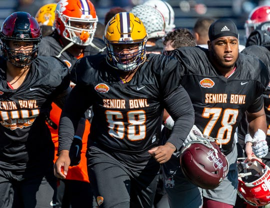 Jan 21, 2020; Mobile, Alabama, USA; South offensive lineman Damien Lewis of LSU (68) leads the South onto the field during Senior Bowl practice. Mandatory Credit: Vasha Hunt-USA TODAY Sports