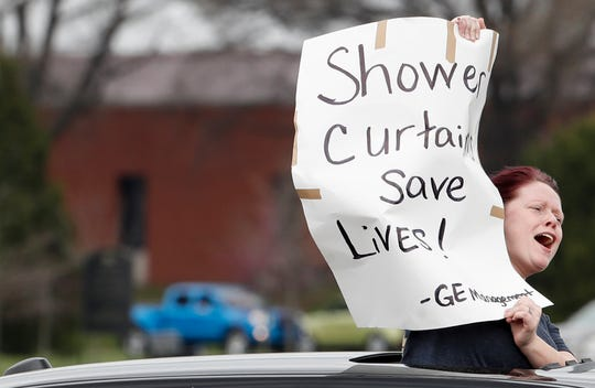 G.E. employee Shelia Marcell protests with her coworkers on March 28 outside of Appliance Park in Louisville. They are upset the have been called to return to work during the coronavirus pandemic.