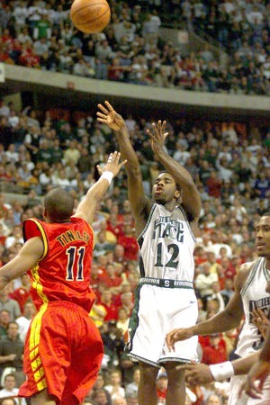 MSU's Mateen Cleaves hits a 3-point shot over Iowa State's Jamaal Tinsley late in the Spartans' 2000 NCAA regional final win.