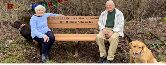 Sue Schamadan and her husband William Schamadan M.D. sat on his surprise birthday bench Saturday on the Richland B & O Trail near Marion Avenue and Home Road.  The OB-GYN physician, now retired, was a longtime News Journal health columnist. He and his wife are celebrating turning 90 this year.  Submitted photo