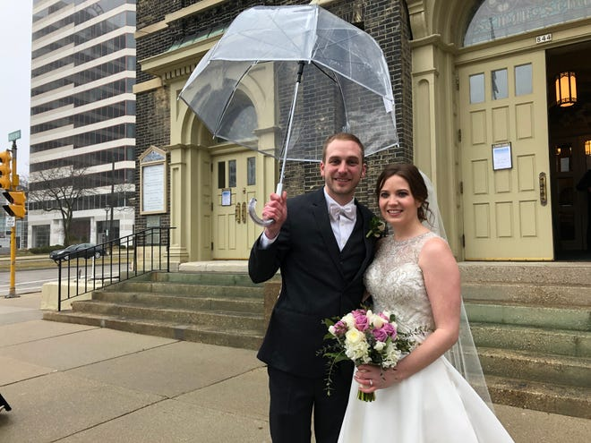 Kevin Kenkel and Katie O'Connor get married at Old St. Mary's Catholic Church on Saturday. The two decided to go through with their wedding despite the coronavirus pandemic.