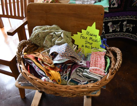 A basket collecting handmade face masks holds about 100 masks Friday morning at the Remember Me Quilt Shop in Mountain Home.