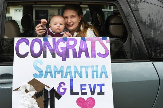 Samantha Yamasaki and Levi Mack get married on Saturday March 28, 2020. Due to the coronavirus the wedding was downsized to a few people. Friends and loved ones surprise the newlyweds with a car parade and a gathering in the street. Catherine Dunlap and son Eli Dunlap wave to the happy couple.