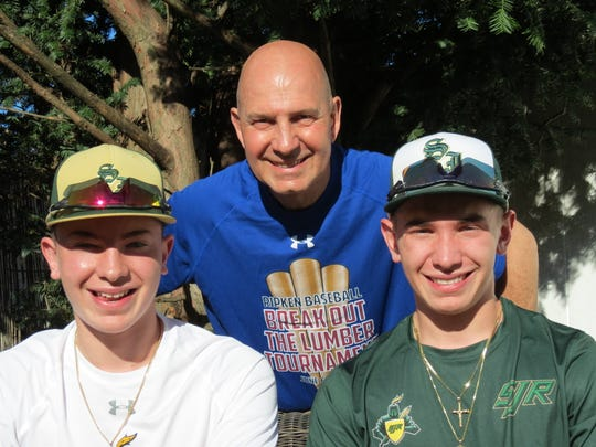 Gary Panissidi (center) flanked by sons Frankie (left) and Anthony (right), who have turned their Maywood backyard into a baseball practice facility while stuck at home due to coronavirus.