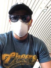 William Kearney wears a surgical mask, while waiting to board a chartered flight from Peru to the U.S. on March 27.