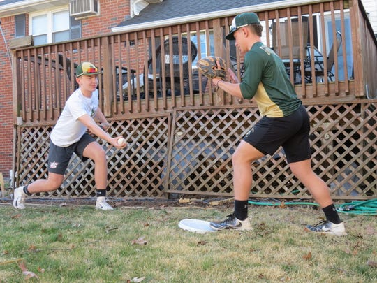 The Panissidi brothers, Frankie (left) and Anthony (right) practice in their Maywood backyard due to coronavirus.