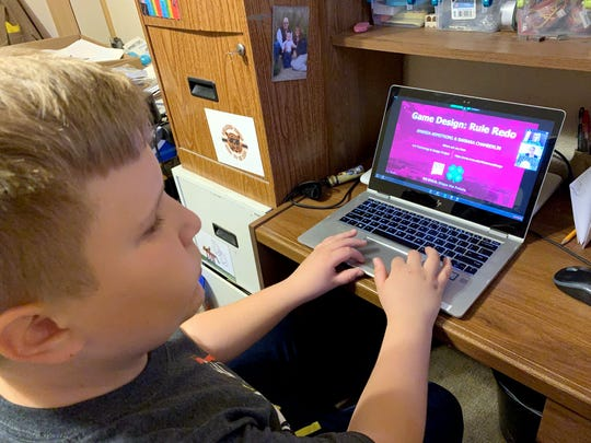 "4-H member John Turner participates in a ""Technology and Design"" project session during the COVID-19 closure of his school. Thirty youth participated in the initial video-conferencing sessions about the basics of creating digital presentations, graphic design, digital illustrations, sound design, animation and game design. Sessions were offered twice a day for 10 days."