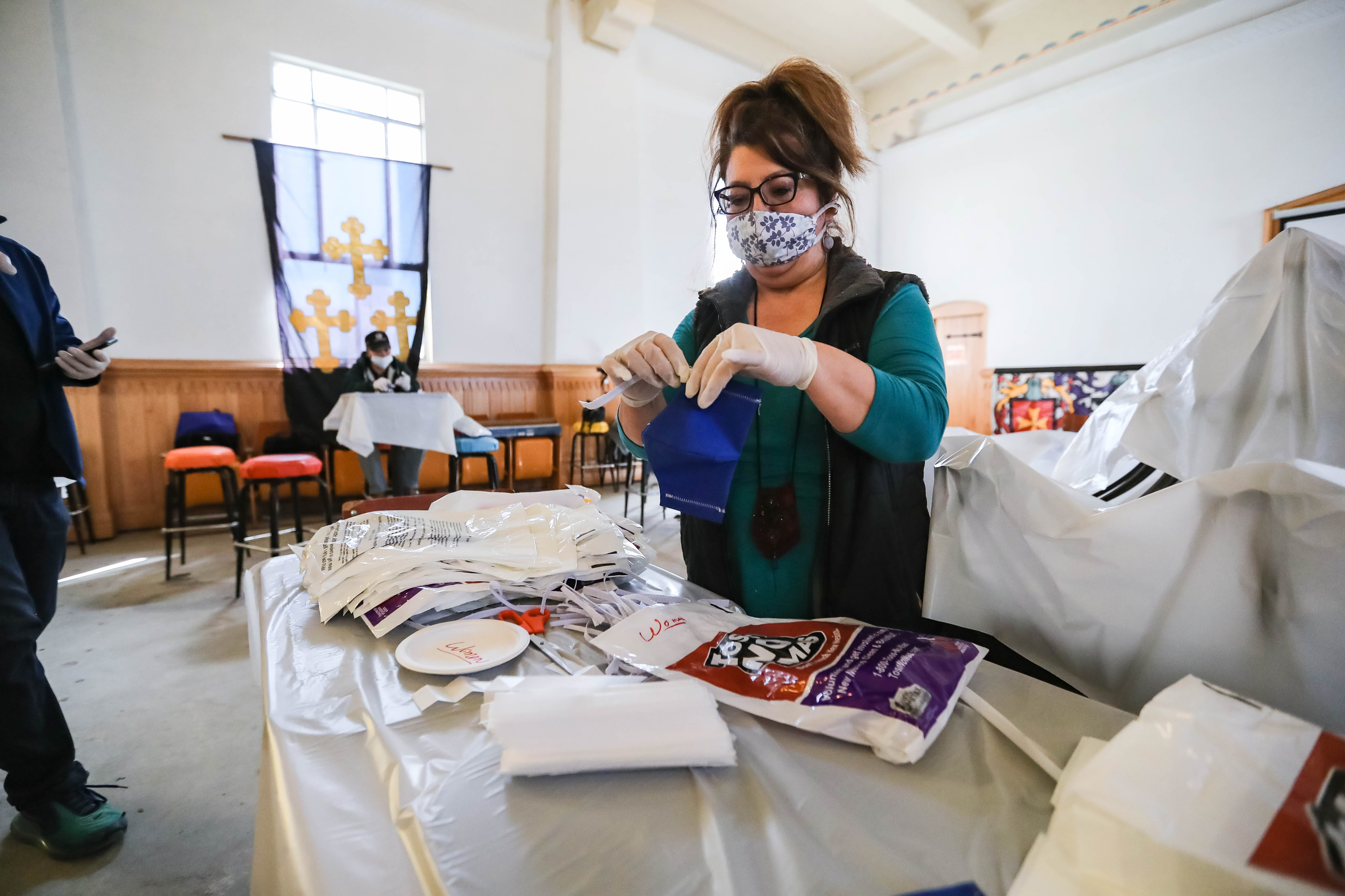 Volunteers make face masks at the historic Doña Ana County Courthouse in Downtown Las Cruces on Saturday, March 28, 2020.