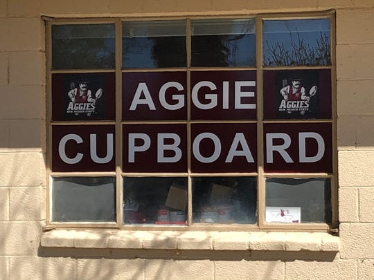 New Mexico State University's on-campus food pantry, Aggie Cupboard, was founded in 2012 with a mission to provide free supplementary food assistance to community members attending or working at NMSU and Doña Ana Community College.