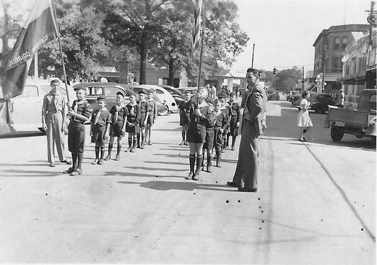 Opelousas Boy Scouts lining up on Court Street on May 5, 1946 for the Knights of Columbus Parade to honor the memory of Father Joseph Verbis Lafleur, a local Army Chaplain who was killed during WWII.