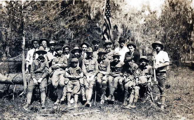 """The first Opelousas Boy Scout Troop formed in 1914. The photo is from the album of Ophelia Pitre Lafleur (Tommy Lafleur collection). The photo was taken by Dr. A. J. Perrault, who was scout master of the troop. Front row: """"Zeke"""" Cresswell, Nathan Haas, Rodney Duson (sitting in front of Nathan Haas), Odel Sanders, Scott Isacks, Theophile Fontenot, Henry Castille and Peck Ventre. Back row: Aaron Lafleur, Guy White, George Brown, Donald Brown, Raymond McBride, Eldon Gil, Clermont Hollier, Ben Cottingham, Clayton J. Guilbeau and Leo Lafleur, with the axe. Leo Lafleur later married Ophelia Pitre."""