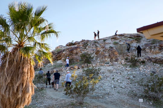 People hike the Homestead Trail in Palm Desert, Calif., on Friday, March 27, 2020. Outdoor exercise is allowed under the shelter-in-place mandate from Gov. Newsom during the virus pandemic. Several hiking trails remain open. Some narrow parts of the Homestead Trail were difficult to maintain six feet for social distancing.