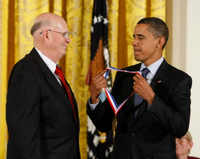 FILE - In this Oct. 7, 2009, file photo, President Barack Obama presents the National Medal of Technology and Innovation to Dr. Forrest M. Bird, of Percussionaire Corp. in Idaho, in the East Room of the White House in Washington. Bird, an inventor whose medical respirators breathed life into millions of patients around the world, died Sunday, Aug. 2, 2015. He was 94. (AP Photo/Gerald Herbert, File)