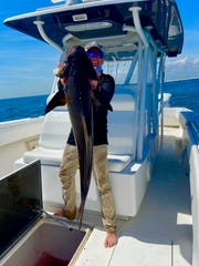 Nick Whibbs posing with a nice Cobia he caught 3/27 while fishing with his dad JP Whibbs Sr. & brother JP Whibbs II while fishing off of Pensacola Beach.