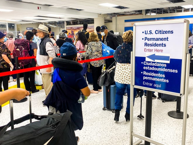 U.S. citizens line up to board a U.S. Immigration and Customs Enforcement aircraft to return to the county from Central America.