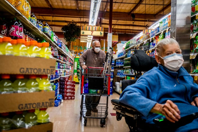 Timothy and Terri Leonard, 73 and 70, shop for groceries at Los Altos Ranch Market in Phoenix during the coronavirus pandemic on March 27, 2020. They say they have hurt financially as the pandemic has worsened, but many people have gone out of their way to help them.
