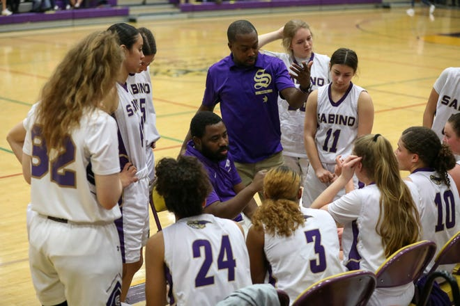Sabino girls basketball coach Jamaal Rhodes (center) and his assistant coach Jeremy Daniels (middle right) talk to their team during a timeout