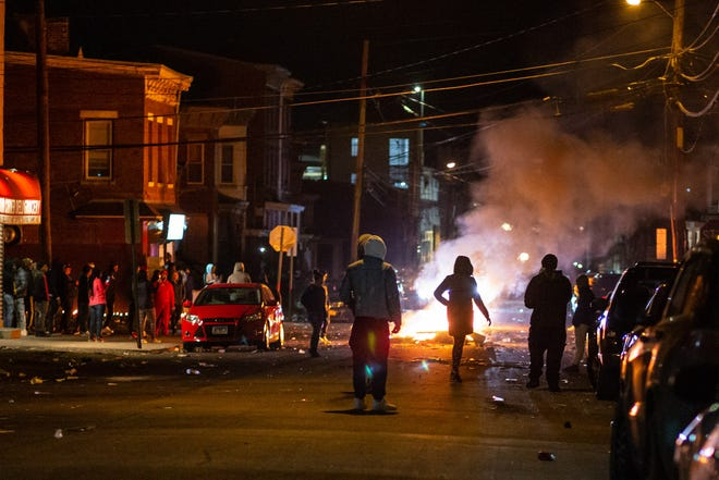 Dozens of people light various objects on fire in the middle of Carpenter and 1st street Newburgh, NY on March 28, 2020. Tensions were high after police shot and killed a man on William street earlier in the day.
