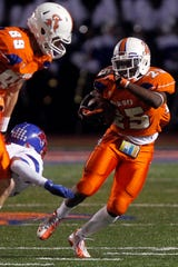 Central High School's Jordan Charles moves the ball up the field in a game against Abilene Cooper on Nov. 2, 2012.