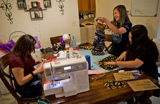 From left: Stephanie Jones, Angela Ayala and Isis Castro make homemade masks for medical professionals working to protect citizens from the coronavirus in San Angelo on Friday, March 27, 2020.