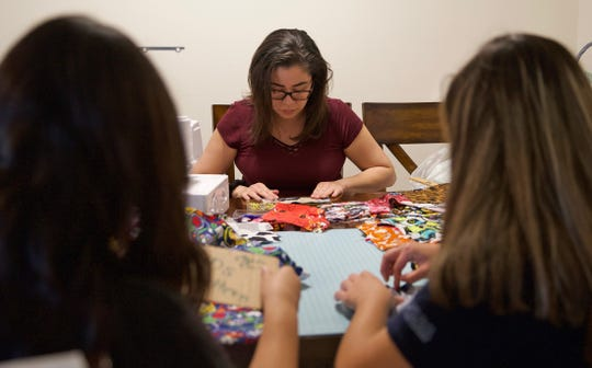Stephanie Jones, center, sews homemade masks for medical professionals working to protect citizens from the coronavirus in San Angelo on Friday, March 27, 2020.