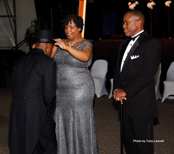 Anthony Reaves and wife Stephanie Reaves present their son Andrew with his Links Beautillion top hat and cane at the 2020 Links Beautillion.