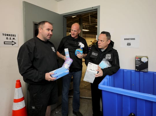 Bobby Kitson, Bob Kressman and Michael Mosiello, the director of the City of Yonkers Office of Emergency Management, look over some donated supplies for Yonkers first responders at their headquarters at 789 Saw Mill River Road in the city, March 28, 2020. The center is accepting donations for the first responders and health care workers. Contact the department at 914-200-8131 or Michael.Mosiello@ypd.yonkersny.gov.