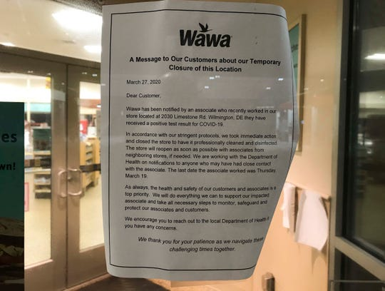 """A notice posted on the front door of the Wawa on Limestone Road in Stanton says the store was closed Friday after an employee who """"recently worked"""" in the store tested positive for COVID-19. The note said the employee had not worked there since Thursday, March 19."""