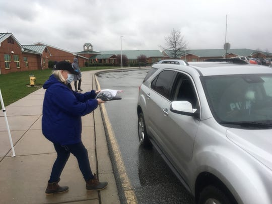 School staff distributed electronic supplies to Colonial School District students on Saturday as schools prepare to go virtual due to the coronavirus closing schools.