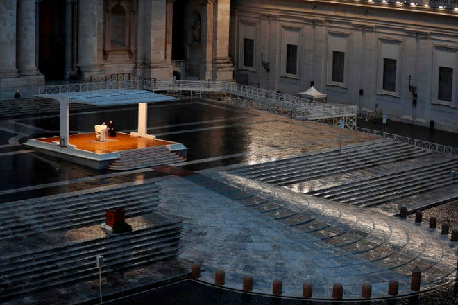 """Praying in a desolately empty St. Peter's Square, Pope Francis on Friday likened the coronavirus pandemic to a storm laying bare illusions that people can be self-sufficient and instead finds """"all of us fragile and disoriented"""" and needing each other's help and comfort."""
