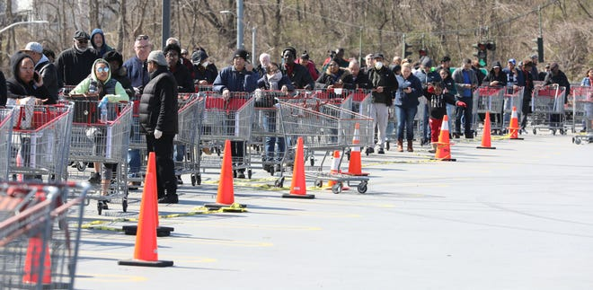 Shoppers at the Costco in Yonkers, line up in two lines along the edge of the parking structure, as they wait to get in to shop.