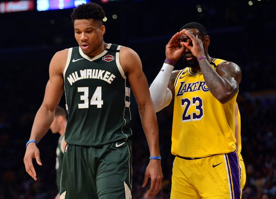 Los Angeles Lakers forward LeBron James and Milwaukee Bucks forward Giannis Antetokounmpo during a March 6 game.