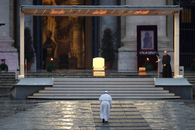 """Pope Francis arrives to deliver an Urbi et orbi prayer from the empty St. Peter's Square, at the Vatican, Friday, March 27, 2020. Praying in a desolately empty St. Peter's Square, Pope Francis on Friday likened the coronavirus pandemic to a storm laying bare illusions that people can be self-sufficient and instead finds """"all of us fragile and disoriented"""" and needing each other's help and comfort. The new coronavirus causes mild or moderate symptoms for most people, but for some, especially older adults and people with existing health problems, it can cause more severe illness or death."""