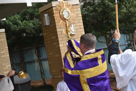 Father Chad Partain of St. Frances Cabrini Church led a Eucharist procession from CHRISTUS St. Frances Cabrini Hospital to conduct a blessing for those who are ill and for the doctors, nurses and other medical staff.