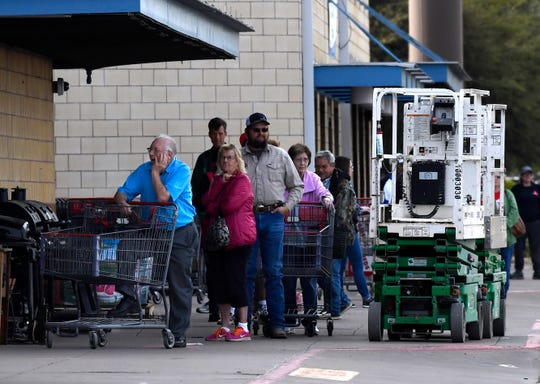 Customers wait in line outside of H-E-B to enter the store early March 29. Abilene has only one store, while other West Texas cities smaller in size have two.