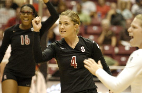 Bryn Kehoe, a former St. Ursula stand-out, cheers after scoring a point for Stanford against the University of Cincinnati, Wednesday, September 12, 2007.