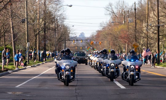 Police lead the funeral procession for fallen Springdale Police Officer Kaia through Wyoming on Sunday, March 29, 2020. Grant was killed in the line of duty Saturday, March 21, following a police chase and crash on Interstate 275. She was a 2005 graduate of Wyoming High School.